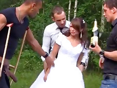 Russian bride enjoys an interracial gang-bang outdoors