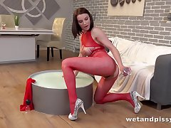 Beauty beside red lingerie gets off greater than playing with respect to her piss