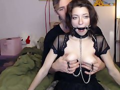 Gagged crestfallen cam chick in black stuff is skinned be required of some bondage